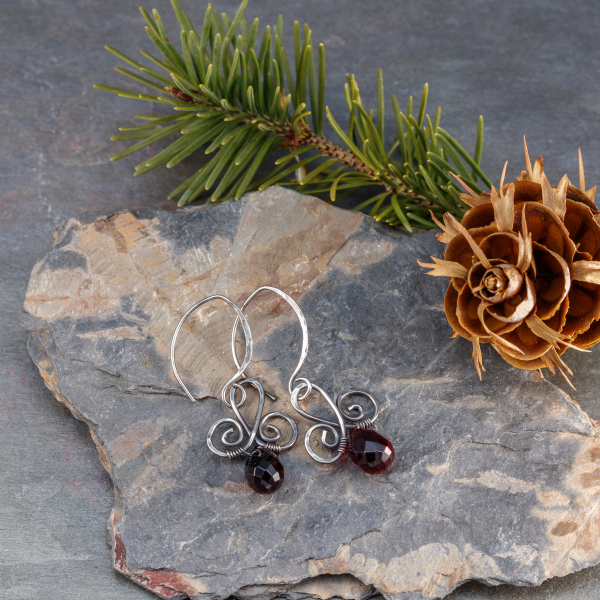 Sterling Silver Scroll Earrings with Deep Red Crystals