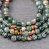 Close up of Green Stones Interspersed with Copper Beads