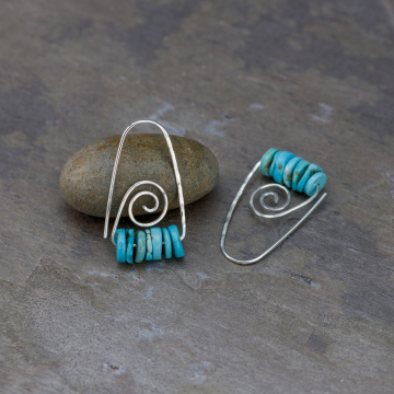 Open Hoops with Primitive Spiral Design
