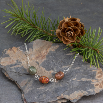 Three jasper stones are set in the front of this delicate sterling silver chain
